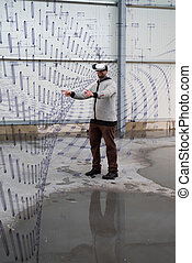 Architect with VR visor exploring industrial building environment