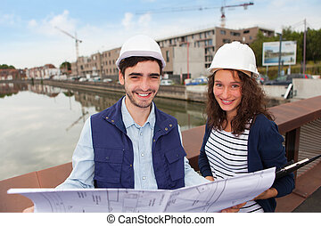 Architect woman and construction site supervisor