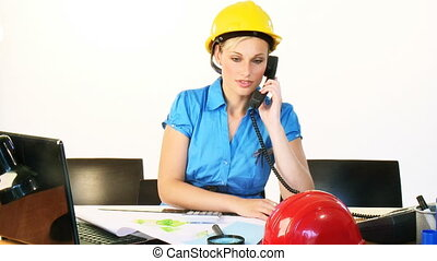 Architect woman on phone in office