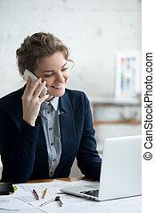 Architect woman on phone