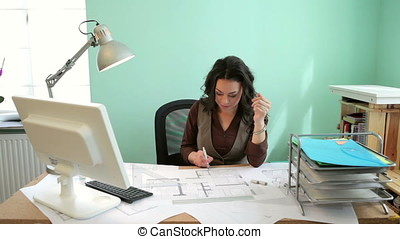 Architect woman working at her desk