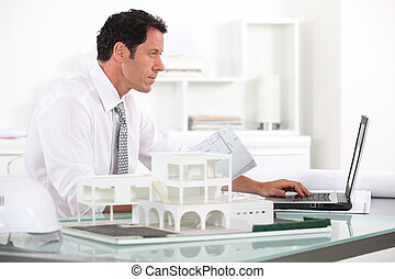 Architect working in his office