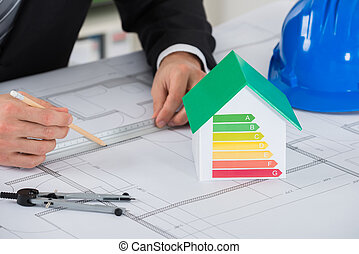 Architect Working On Blue-print In Office