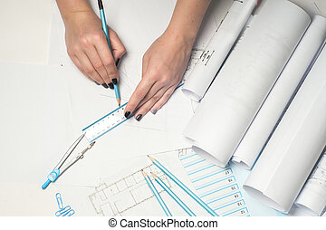 Architect working on blueprint.