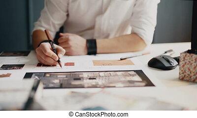 Architect working on blueprint close up