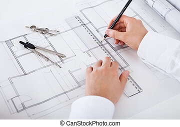 Architect working on blueprints - Closeup cropped image of a...