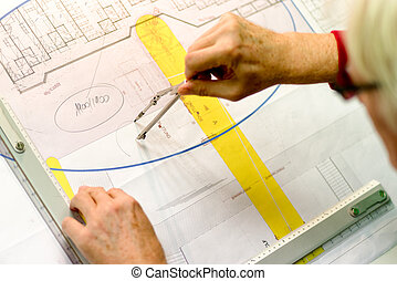 Architect working on drawing board