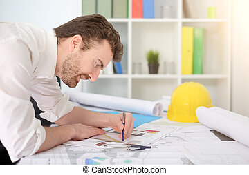 Architect working on his projects paper in the office