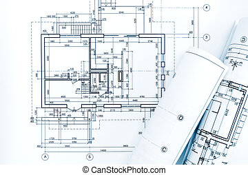 architect workplace with project plans and rolled blueprints