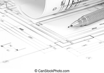 architect workspace with floor plan, blueprint roll and pencil