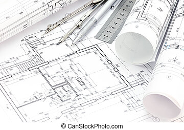 architect workspace with floor plan, blueprint rolls, drawing compass, ruler and pencil