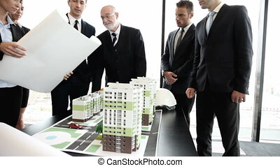 Architects and investors with model