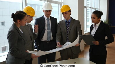 Architects - Business team discuss a architectural design