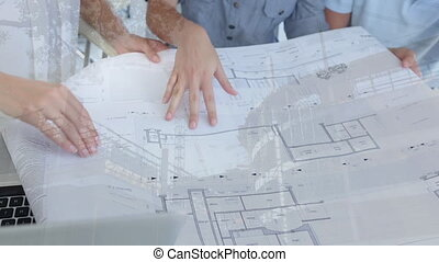 Architects discussing blueprints with construction site