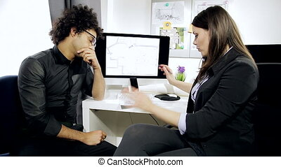 Architects in office discussing