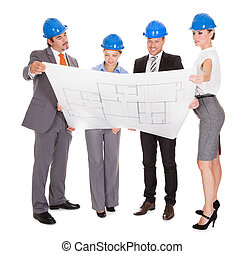 Architects Looking At Blueprint