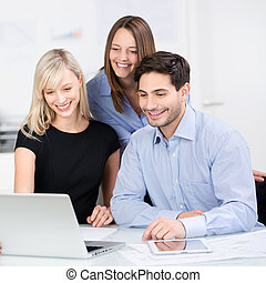 Architects Looking At Laptop In Office