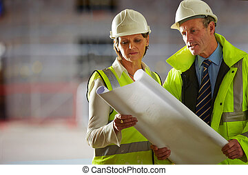 Architects looking over the blueprint