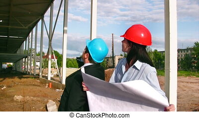 Businessteam on construction site of shopping center