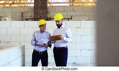 Architects or civil engineers at the construction site.