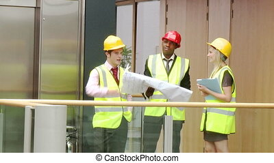 Architects studying a construction project