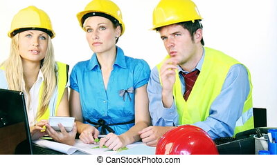 Architects studying construction plans footage