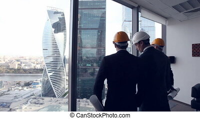 Architects with construction project