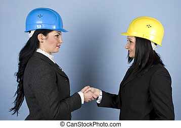 Architects women shaking hands