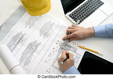 Architects working on blueprint, Architect workplace.