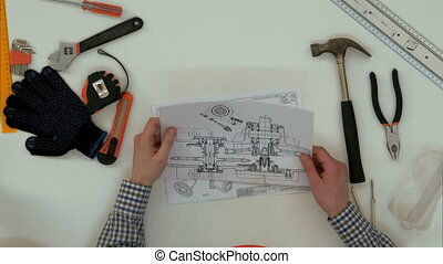 Architects working on blueprints with divider compass. Close...