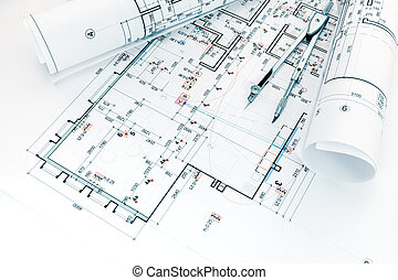 architects workplace with project plans and drawing compass