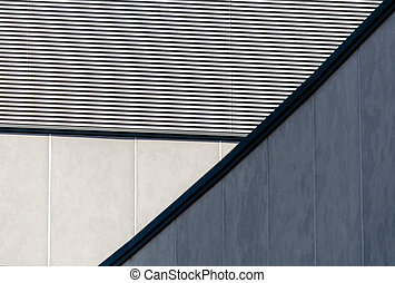 architectural abstract background of a striped wall and concrete walls close up