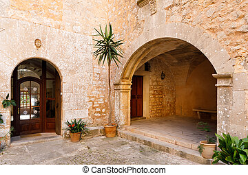 Architectural arch in the old town of Santanyi, Spain