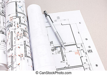 architectural blueprint rolls and plans on desk