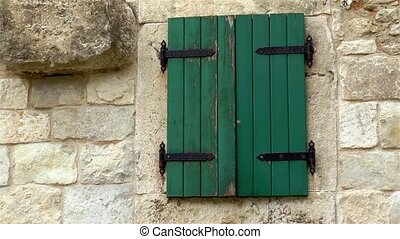 Architectural detail in ancient Split, Croatia. An old window with closed shutters in the Diocletian's Palace.