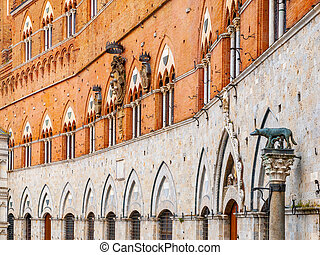 Architectural detail of front facade of Siena Town Hall, Palazzo Pubblico, at the Piazza del Campo, Tuscany, Italy, Europe