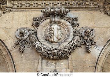 Architectural details of Opera National de Paris: Bach Facade sculpture. Grand Opera is famous neo-baroque building in Paris, France - UNESCO World Heritage Site