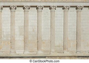 Row of greek pillars on a wall