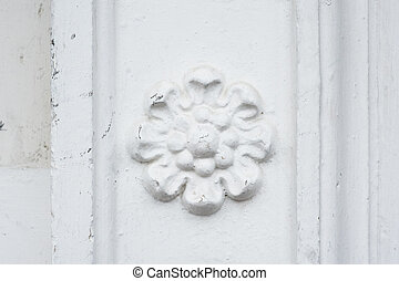 architectural flower fresco on the wall of a building