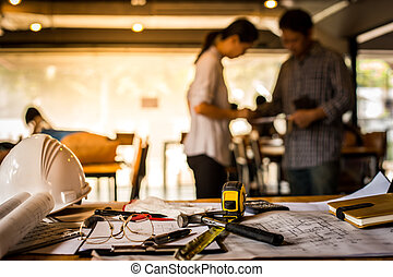 Architectural Office desk background construction project ideas concept, With drawing equipment with mining light.