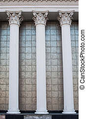 Architectural white columns on the facade of the building