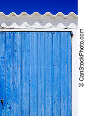architecture balearic islands white blue doors detail