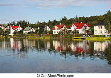 Architecture in Reykjavik, Iceland. Homes by the lakeside.