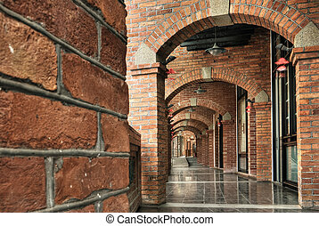 brick hallway - Architecture of old brick hallway in red...