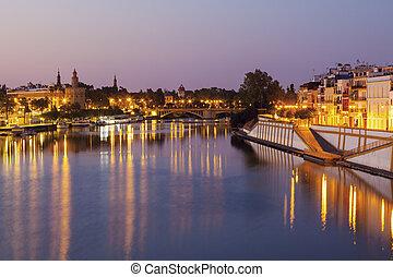 Architecture of Seville along Guadalquivir River. Seville, ...