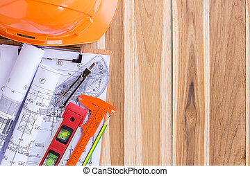 Architecture plan and rolls of blueprints with tool kit
