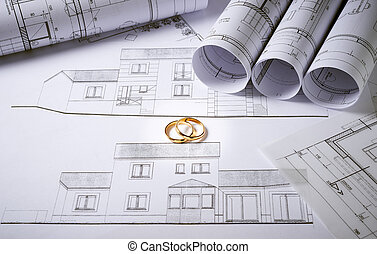 Architecture plans with wedding rings