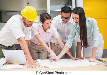 Architecture team working together at desk