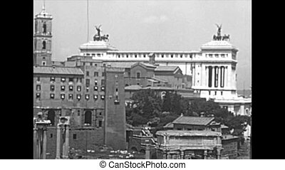 Aerial of Campidoglio of Rome and Altar of the Fatherland. Historical Senatorio palace, Settimio Severo arch and Column of Foca. Roman Forum. BW archival of Rome capital of Italy in the 1960s