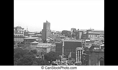 Aerial view of the churchs Santi Luca e Martina and San Lorenzo in Miranda, Altar of the Fatherland and Trajan Forum. Roman Forum in Rome city. BW historical archival of Rome capital of Italy in 1960s